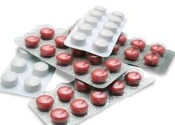 коричневые и белые таблетки